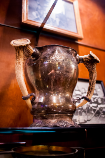 One of the old trophies found in the building during renovations, this one from 1915.