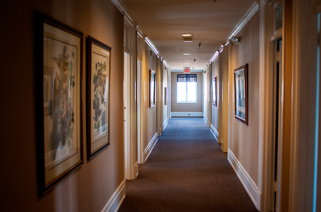 A look down the 4th floor hallway, where old sleeping rooms have been converted info office space.