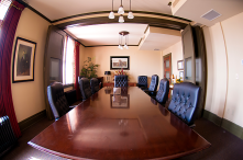 The board room, where pocket doors were discovered when tearing down the wall that originally separated the two spaces.