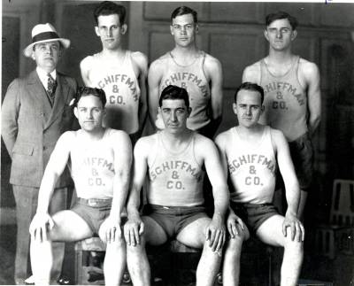 Circa 1930, Robert Schiffman, in suit and hat, managed a local basketball team.